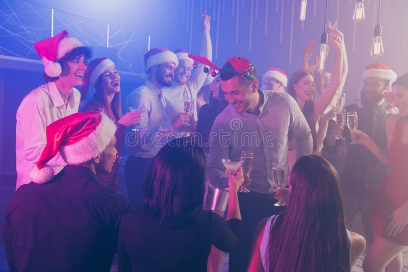 Nice attractive stylish fashionable cheerful cheery positive ladies and guys gentlemen having fun rest relax celebratory royalty free stock photography