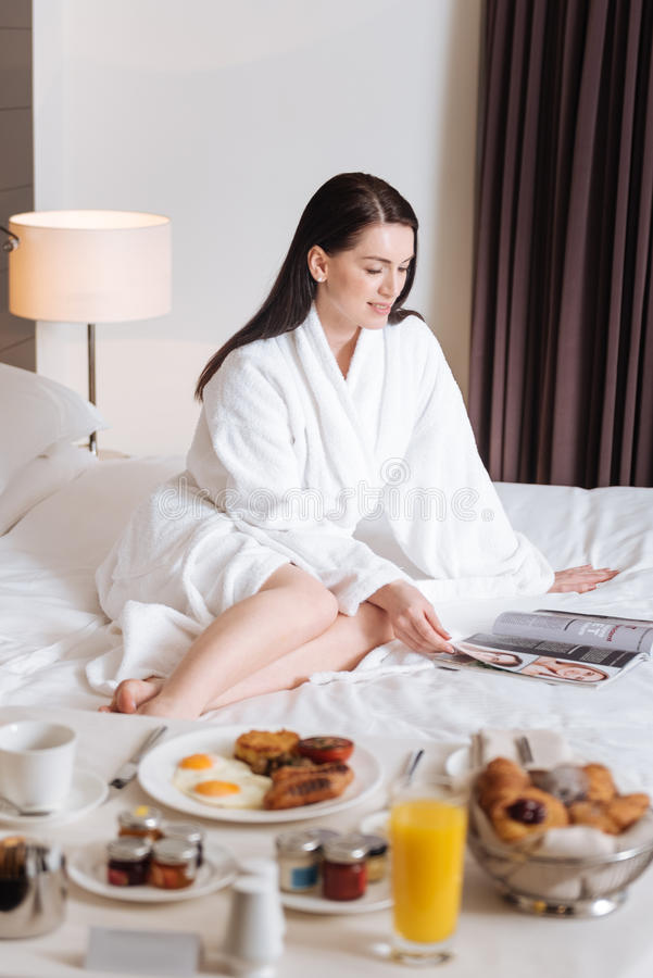 Nice attractive woman waiting for her breakfast stock images