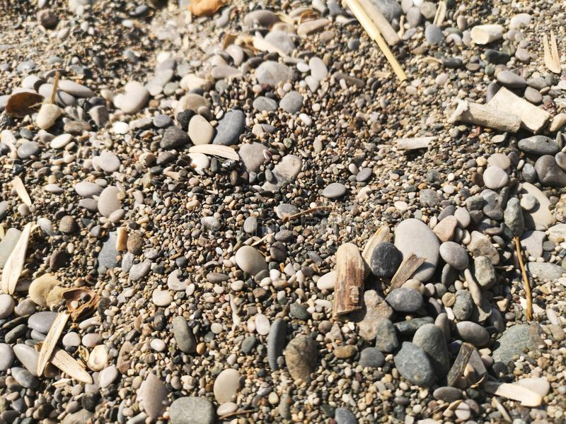 Pebble stones sprinkled with garments stock photos