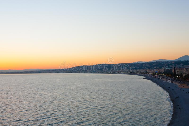 Nice beach day view, France. Nice beach day landscape, France. Nice beach and famous Walkway of the English, Promenade des Anglais. Famous French touristic town stock images