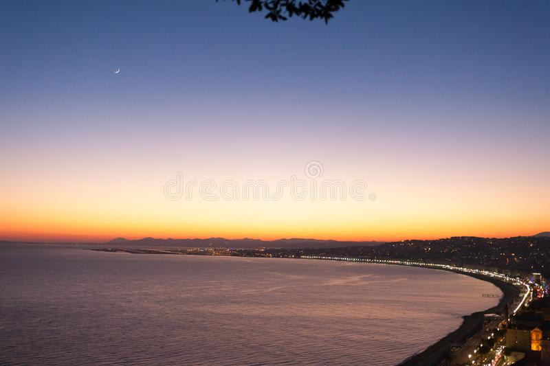 Nice beach night view, France. Nice beach night landscape, France.  Nice beach and famous Walkway of the English, Promenade des Anglais. Famous French touristic royalty free stock photos