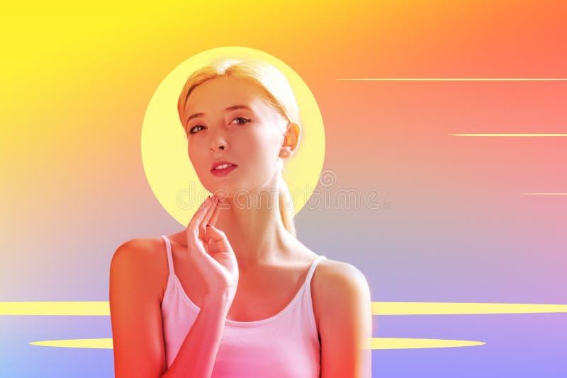 Nice beautiful young woman touching her neck stock photo