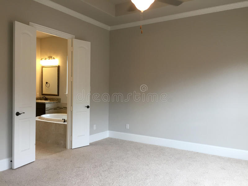 Nice bedroom and bathroom in new house. A nice bedroom and bathroom in a new house stock photos