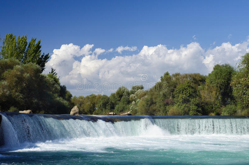 Nice big wide waterfall with crystal clear water. On a clear summer day royalty free stock photos