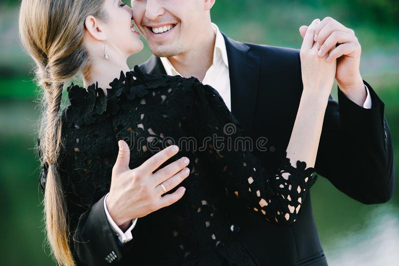 Nice black dressed couple waltzing and laughin stock image
