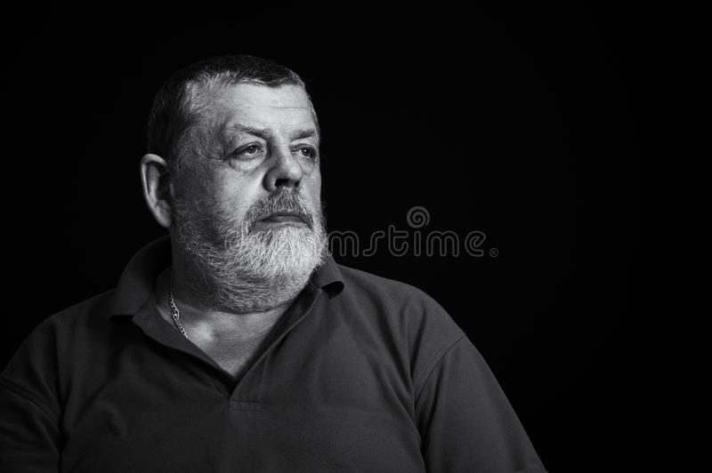 Black and white portrait of a thoughtful senior man royalty free stock photography