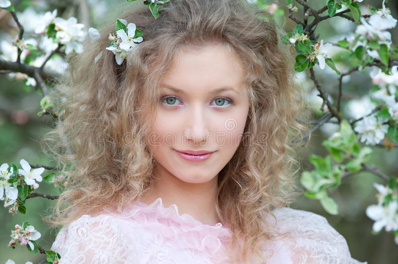 Nice blonde with curly hair. Posing in orchard stock image