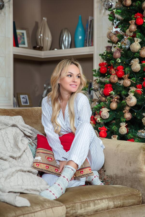 Nice blonde dressed in pajamas royalty free stock photography