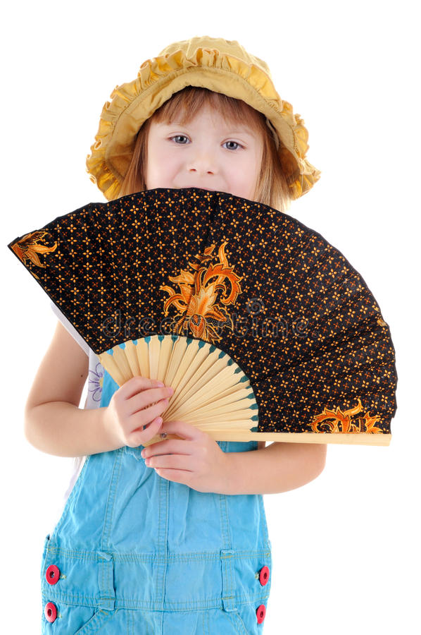 Nice blonde girl with a fan royalty free stock photography
