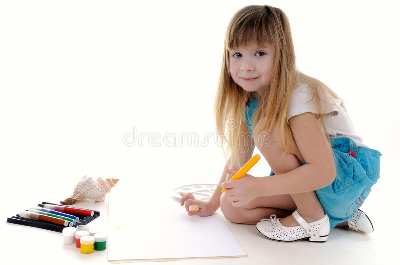 Nice blonde girl is painting royalty free stock photo