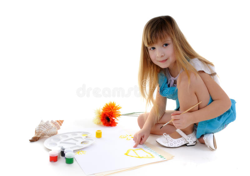 Nice blonde girl is painting stock photography