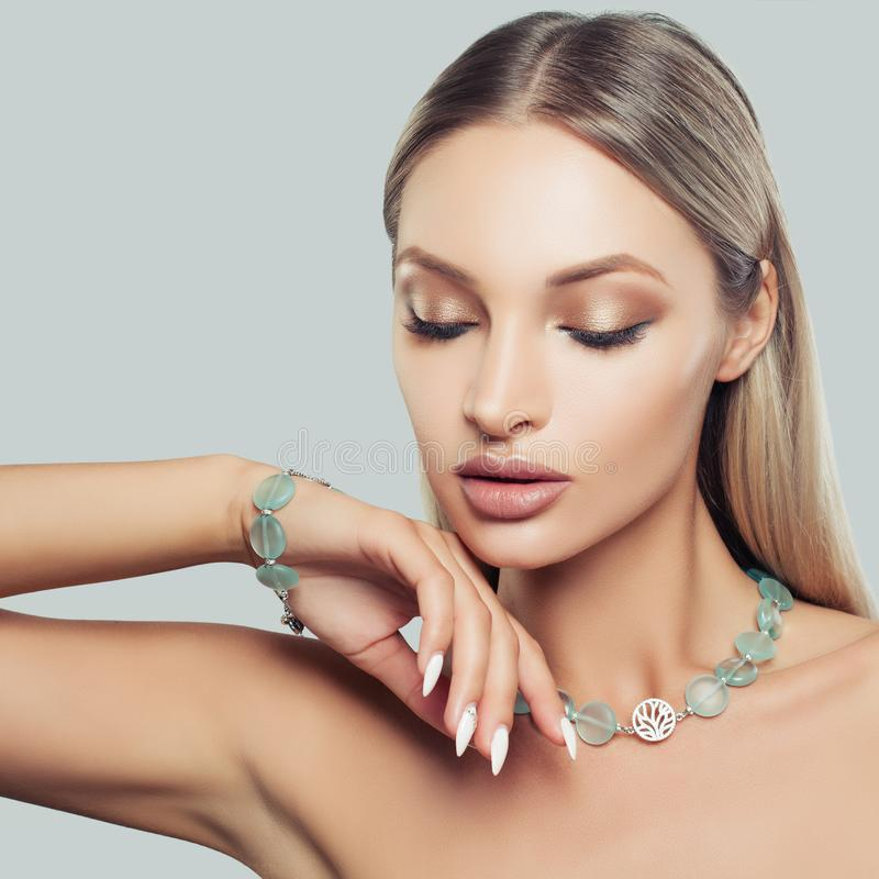 Nice Blonde Hair Woman Wearing Jewelry Necklace. And Bracelet, Fashion Beauty Portrait. Glamorous Makeup and Accessories stock photos