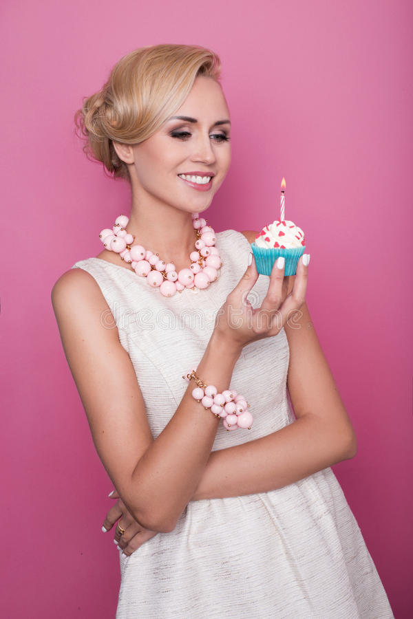Nice Blonde Woman Holding Small Cake With Candle Birthday