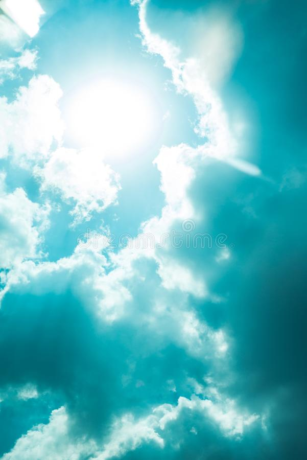 Nice blue sky clouds day with corona sun gap summer time stock image