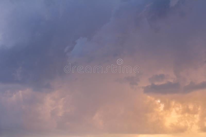 Nice blue storm clouds texture with yellow color royalty free stock photo