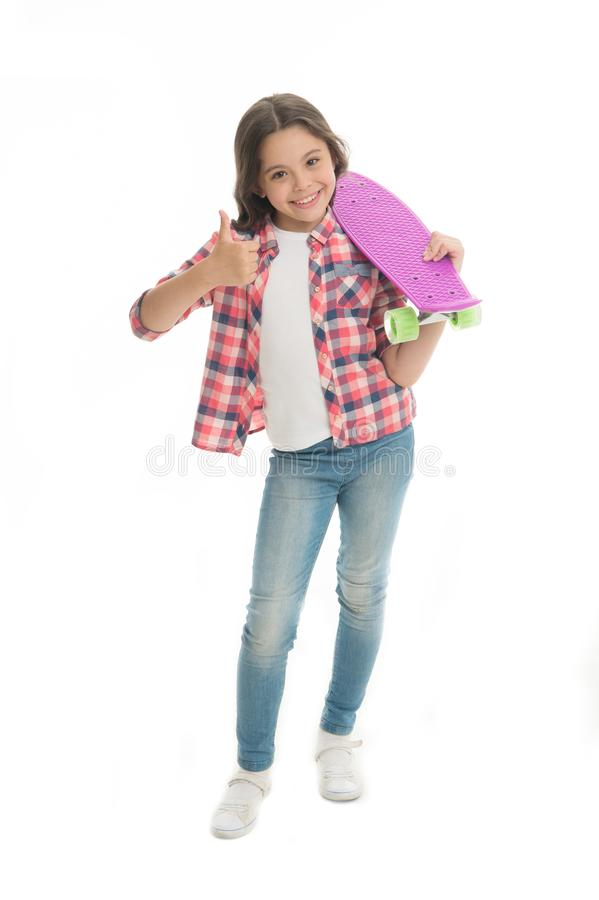 Nice board. Kid girl happy holds penny board. Modern teen hobby. Girl happy face carries penny board white background stock photography