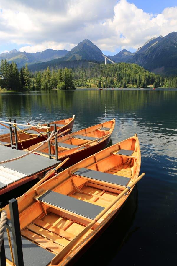 Nice boats on moorage. In mountain lake Strebske Pleso, Slovakia royalty free stock image