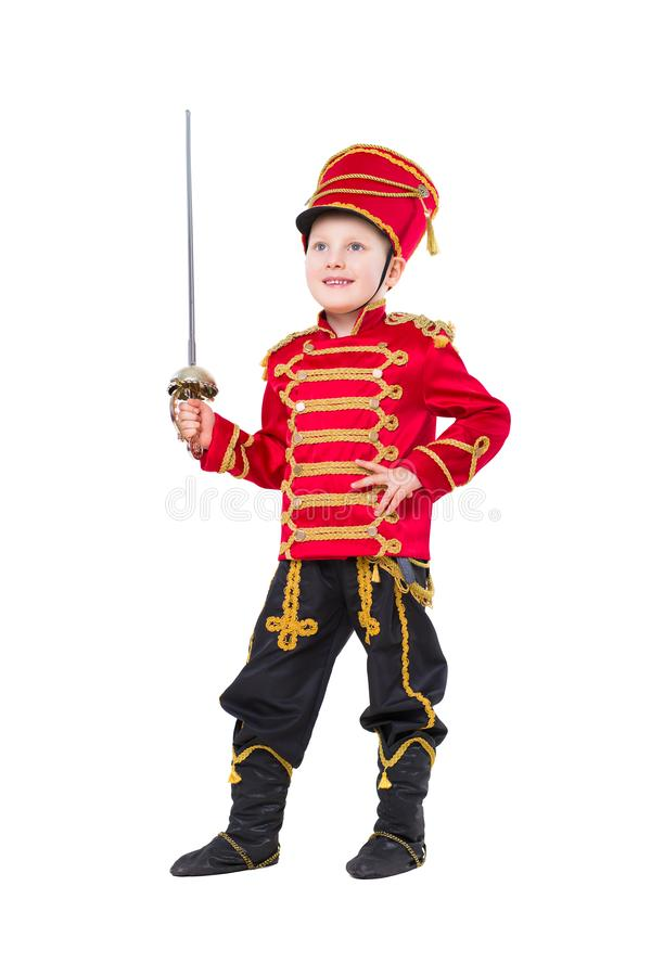 Nice boy wearing like guardsman. Posing with a sword. Isolated on white stock photography