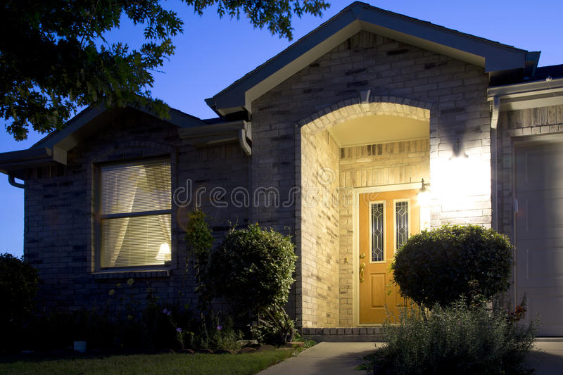 A nice brick house in friendly community night. TX USA royalty free stock photos