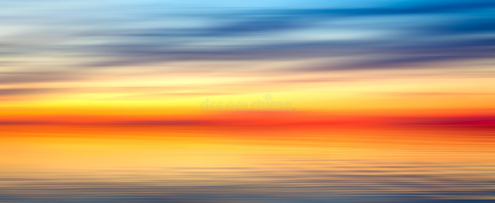 Nice bright red yellow blue abstract blur horizontal texture background panorama landscape with sunset lake royalty free stock photos