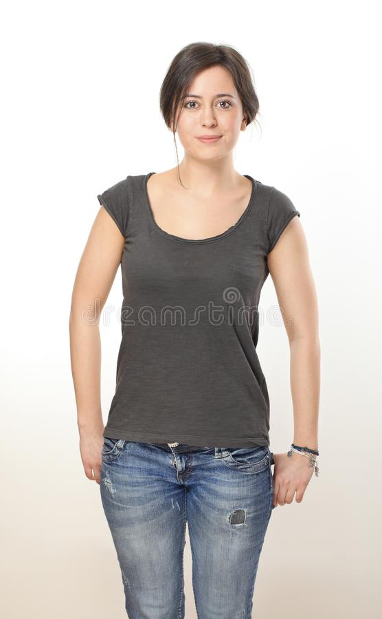 Nice brunette woman in T-shirt and jeans royalty free stock images
