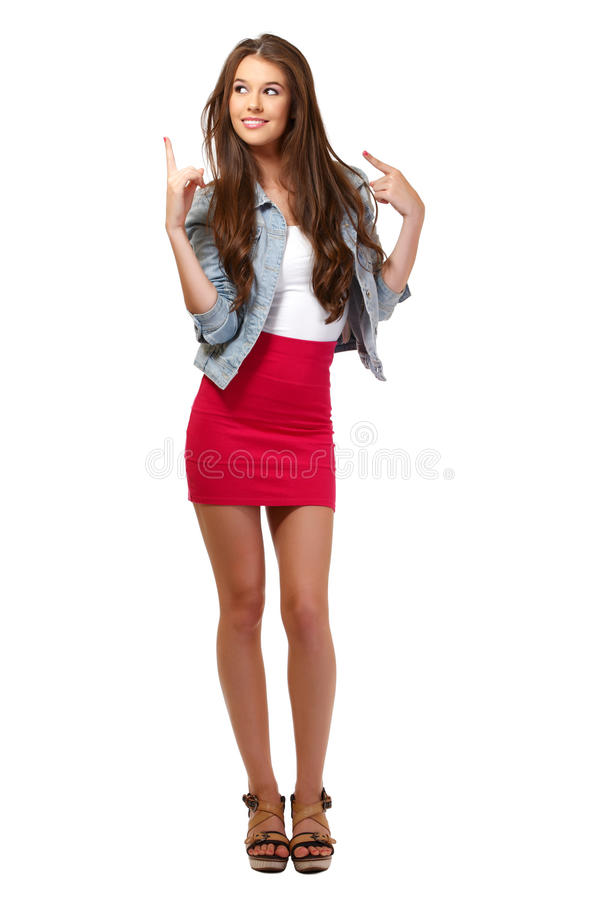 Nice brunette young woman pointing at copyspace stock photo