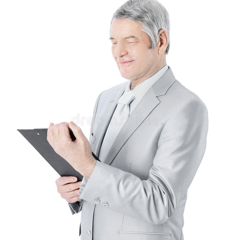 Nice businessman at the age, studying the work plan. Isolated on a white background. Nice businessman at the age, studying the work plan stock images