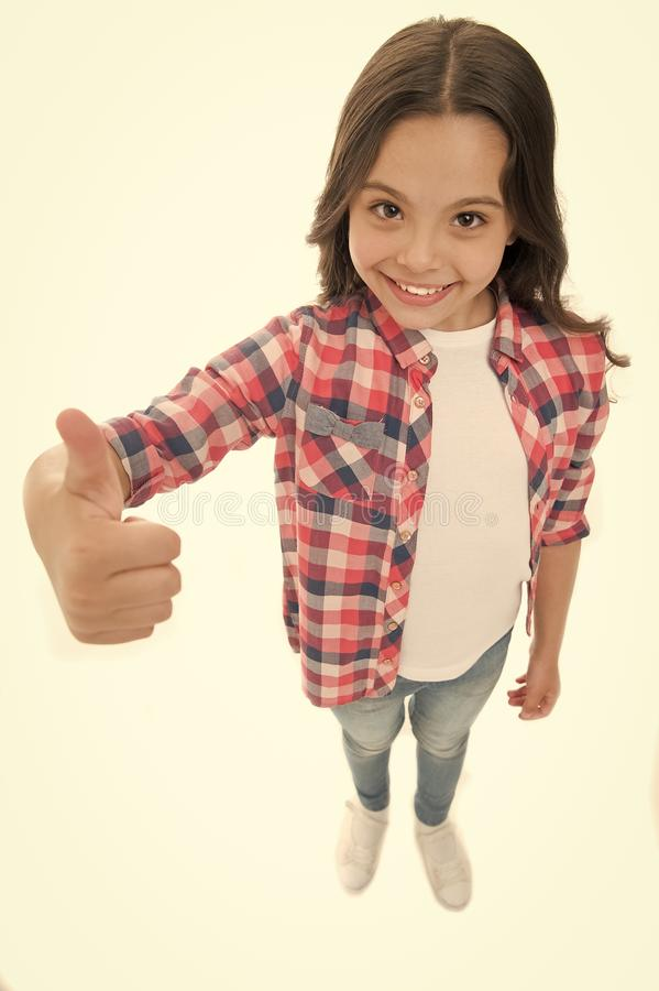 Nice choice. Highly recommend. Kid girl shows thumb up gesture, isolated white background. Girl happy smiling. Recommendation. Child highly recommend with thumb stock image