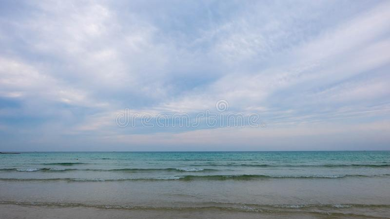 Cloudy weather in Hamdeok beach, Jeju Island. Nice cloudy weather made the light so soft. Baby blue color sky made the photo look like a painting stock photos