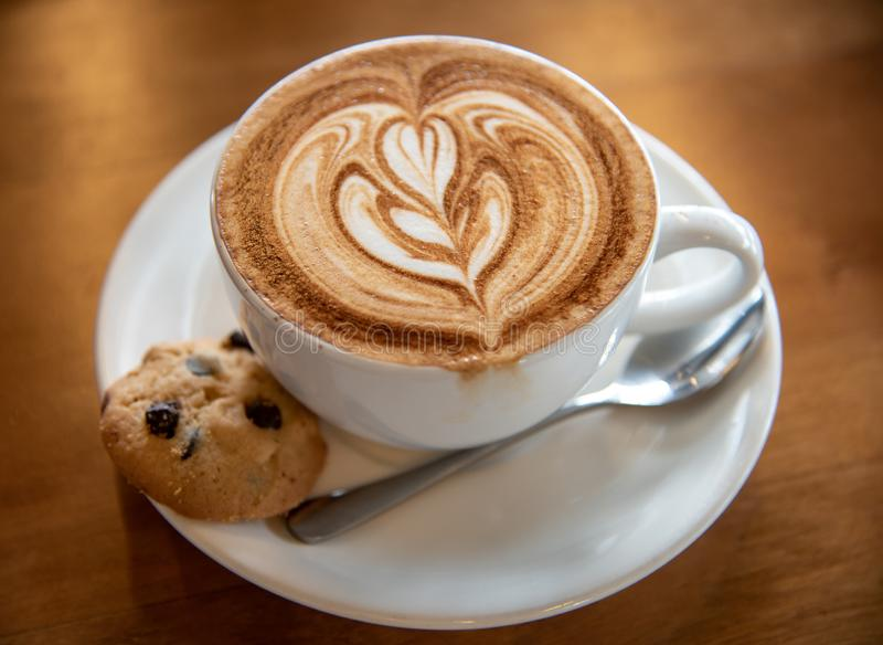 Nice coffee latte with cookie royalty free stock photos