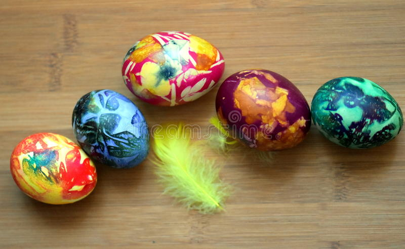 Nice colorful eggs on a wooden table stock photo