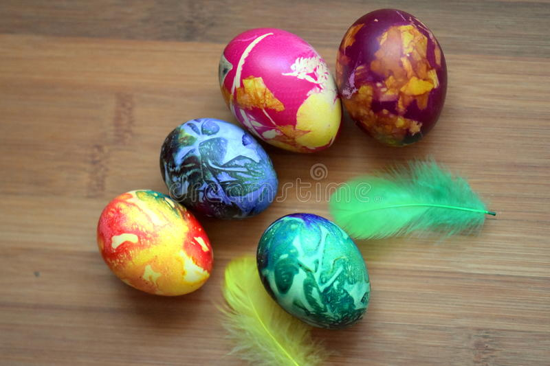 Nice colorful eggs on a wooden table royalty free stock photos