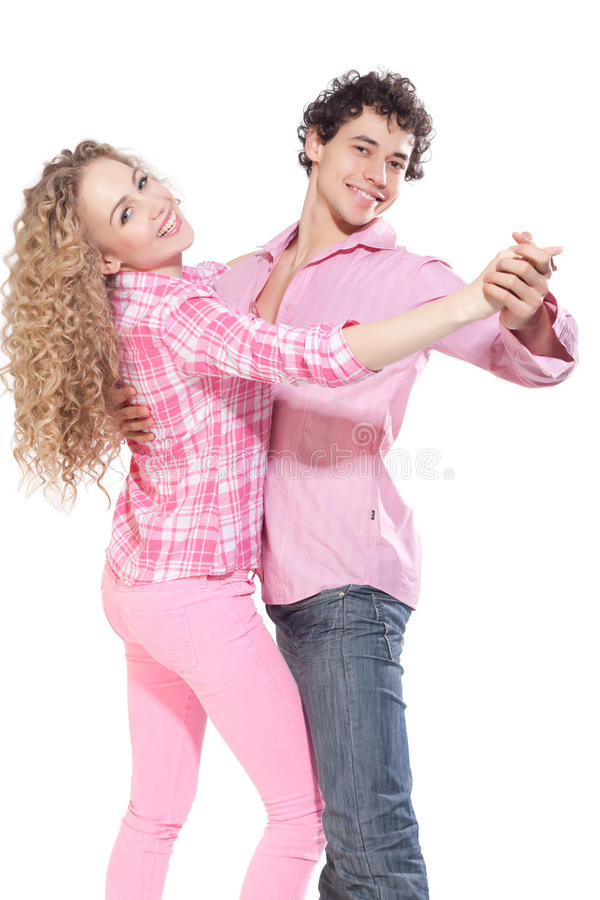 Nice couple dancing in studio royalty free stock photography