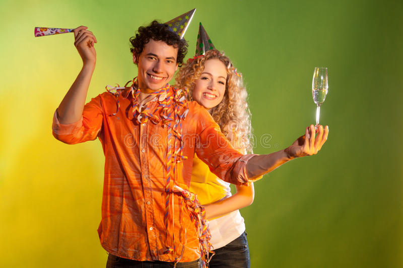 Nice couple have fun on colorful background royalty free stock images