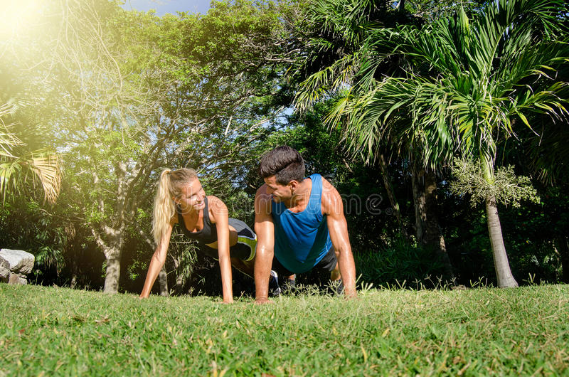 Couple push up at the park. Nice couple push up at the park royalty free stock photos