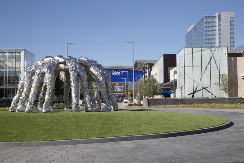 Cowboys huddle sculpture and Ford center Frisco. Cowboys huddle sculpture and practice facility in Ford center ,the star city Frisco Texas USA stock photo