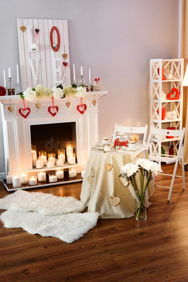Nice cozy room decorated for a romantic date on a St. Valentines Day stock photo