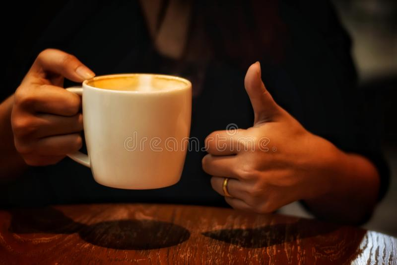 Nice cup coffee in women hand royalty free stock images