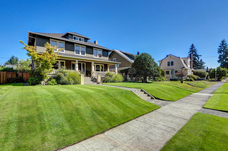 Nice curb appeal of American craftsman style house. stock image
