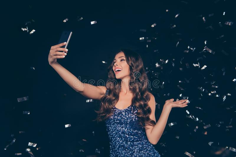 Nice cute cheerful cheery optimistic clubber diva adorable charm. Ing attractive sweet lovely wavy-haired lady taking making self photo in nightclub on device stock photos