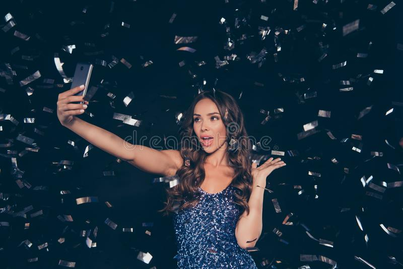 Nice cute positive clubber diva adorable charming attractive win. Some sweet lovely wavy-haired lady taking making self photo in nightclub on smart camera royalty free stock images