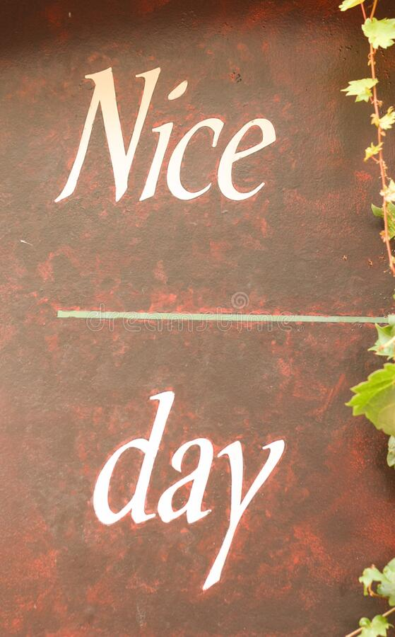 A have a `Nice Day` script on a red marbled background. The words `Nice Day` on a red and black background encouraging the viewer to fill in what makes a day royalty free stock photo