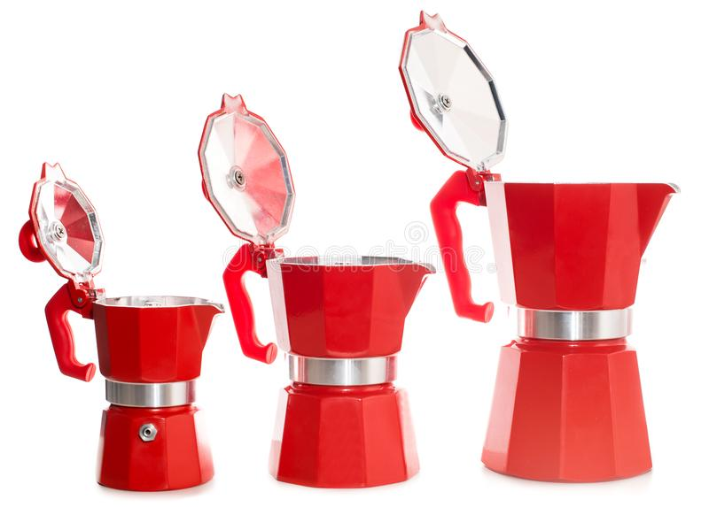 Set of geyser coffee maker. Nice design of the set of red geyser coffee maker ital. la moka on the table royalty free stock photos