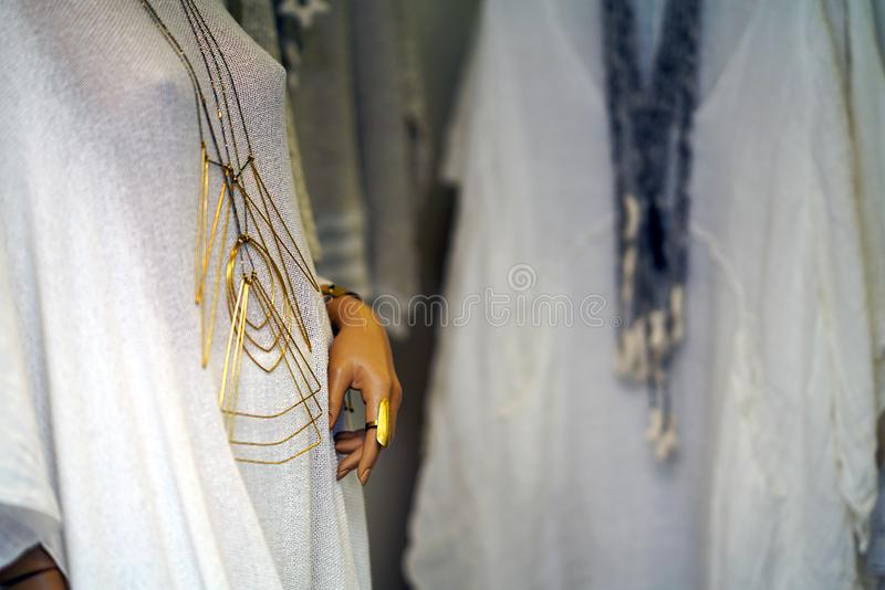 Nice detail of a mannequin in the window of a shop in Parikia. Greece neck cotton color craft feminine beautiful scarf background summer wearing clothing many stock photo