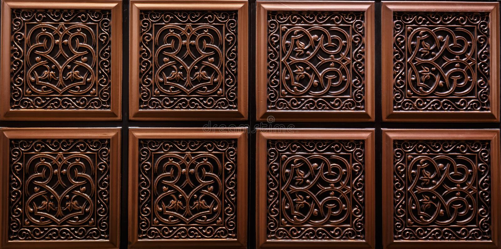 Nice detailed closeup view of dark brown color interior ceiling tiles luxury background stock images