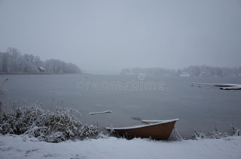 Nice details photo of frosty snowy boat frozen in lake in Sweden Scandinavia at winter stock photo