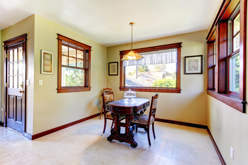 Nice dining room with wood walls stock image