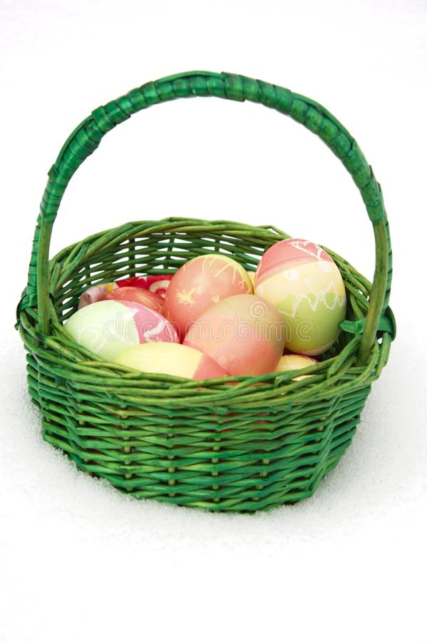 Easterbasket in snow royalty free stock photo