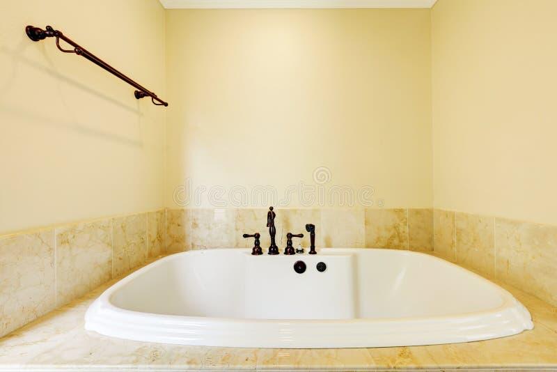 Nice empty bathroom with large white tub stock photos