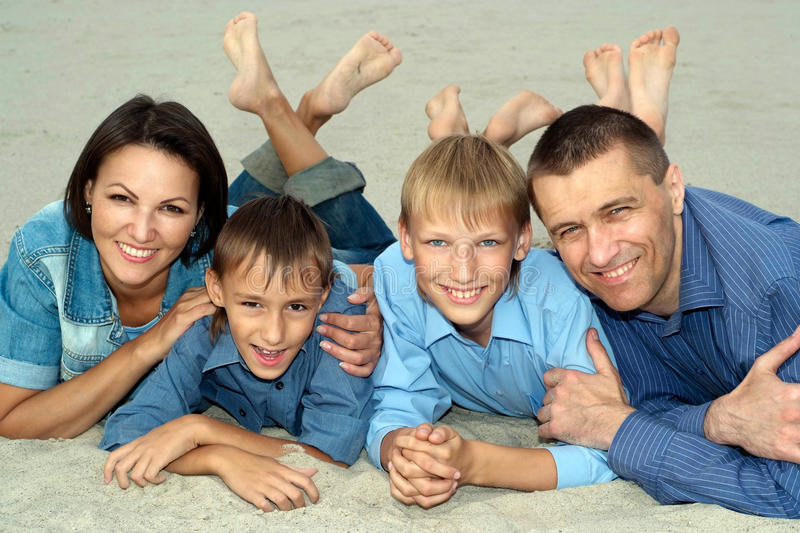 Nice family of four lying stock photos